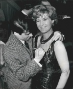 Mike autographing actress Patsy Fagan's chest